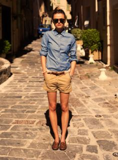 chambray shirt, beige shorts, brown loafers/oxfords, brown belt, sunglasses, bun