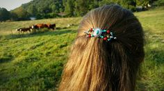 Doing farm chores wearing 'Susannah', a new flexi clip design from Lilla Rose. Working in the fields or in the barn, my clothes may get dirty but my hair looks great!