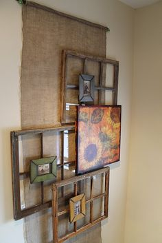 Definitely going to do this:  Burlap hanging down large wall of stairwell with three shabby windows hung at varying levels and depths, small frames attached to windows with sepia tone pictures in them, then a large painting on canvas or pallet wood on top.  Need to come up with subject matter for photos and painting.