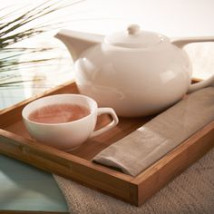 Host the world's greatest tea parties with this sleek and modern tea set. Tray chic!
