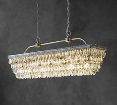 Clarissa Crystal Drop Rectangular Chandelier | Pottery Barn - i don't love the metal finish on these PB pieces, but the overall look is kind of nice.