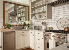 Vintage accents in kitchens - mirror above sink to add light and depth to space