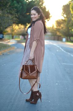 Fashion Blogger Girl With Curves Layers a shirt dress over polka dot midi skirt.  Cute