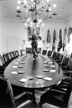 """First Lady Betty Ford, Washington, DC, 1977 - photo by David Hume Kennerly -- """"I always wanted to dance on the Cabinet Room table.""""  Posing atop that table, the day before her husband left office. Mrs. Ford had been a dancer with Martha Graham's troupe, and had an agile sense of humor, as exhibited here."""