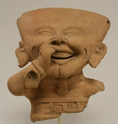 Fragmentary Smiling Figure, 6th–9th C.  Veracruz, Mexico. Remojadas culture. Ceramic. Metropolitan Museum of Art, New York.