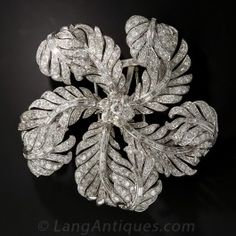 Large Platinum and Diamond Vintage Corsage Brooch - A sparkling pinwheel comprised of blinding bright-white diamond feathers make for the most magnificent and mesmerizing corsage brooch ever! This opulent, multi-dimensional ornament contains 20 carats of round and baguette diamonds, and each articulated section is ingeniously designed to create extra sparkle with your every movement. A truly stunning, spectacular and awe-inspiring jewel!