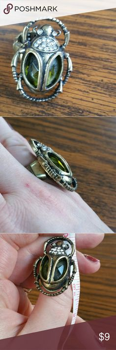 Brass and green beetle stretchy ring Brass beetle with gren glass wings and crystal encrusted head stretchy ring.  Comfortable for size 6 to 11.  Excellent used condition. Jewelry Rings