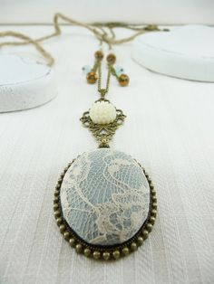 Off white lace and light blue fabric pendant - Vintage style necklace - Antique bronze tone chain - Resin flower and beads (C078)