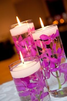 Orchids with floating candles #ChristinaCurrieEvents