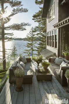 """GLASS BARRIER – On the deck outside a Canadian cottage, Anne Hepfer installed frameless glass panels instead of railings, both for safety and to shield from wind blowing off the lake. What's more: """"It's the best spot to watch sunsets, since glass doesn't obscure the view."""" Click for more patio ideas."""