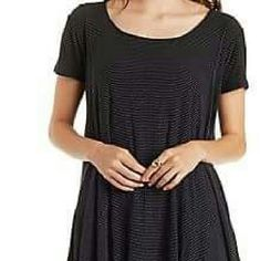 Textured Stripe Swing Tee Black and white raised stripe swing tee with flowy fabric. Back has a keyhole cut out. Literally fits a small or medium. Charlotte Russe Tops