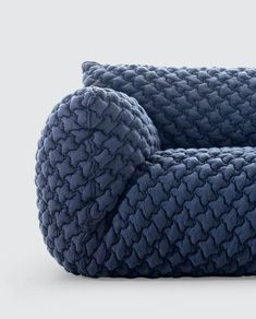 Textured blue-grey sofa is a both plush and contemporary.