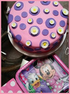 Daisy Duck and Minnie Mouse Theme'd Baby Shower Cake! Vanilla cake with fresh strawberries and a strawberry preserve filling!