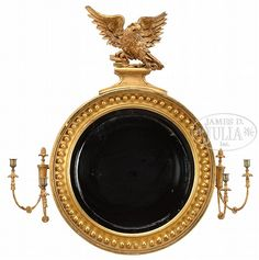 "LARGE FEDERAL GILTWOOD CARVED GIRONDOLE MIRROR. First quarter 19th Century American. The round convex mirror plate within a reeded ebony slip set within a molded surround, mounted with spherules flanked by double candle arms each suspended beneath a ropetwist torch. Crested with a well carved giltwood displayed eagle, a ball and chain within its beak, perched on rockwork on a classical form gilt plinth. SIZE: 45"" h x 42"" w x 7-1/2"" d Victorian Style Homes, Victorian House, Colonial Furniture, Antique Furniture, Antique Mirrors, Mirror Plates, Convex Mirror, Decoration, 19th Century"