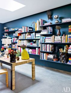 Slate bookshelves line the gallery's office area | archdigest.com