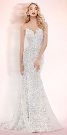 Ivory Marrakesh beaded fit to flare bridal gown, sweetheart neckline with spaghetti straps and low scoop back, elongated bodice with ivory embellishment over cashmere lining and full circular skirt.