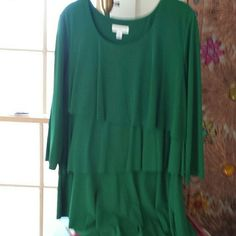 Beautiful tiered top by susan graver This is a lovely vibrant green almost a kelly green with tiers going down the front and the back three quarter length sleeve has a nice weight to it I would say kelly green it is a deep green beautiful blouse Susan Graver Tops Blouses