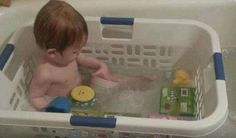 What a great thrifty alternative to buying expensive baby tubs.  Just use a laundry basket!