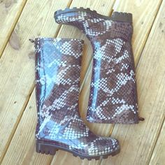 Rain Boots Rain boots in a snake skin pattern! Size 6. In great condition! Make me an offer! Shoes Winter & Rain Boots