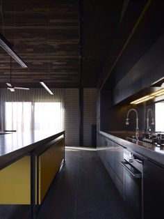 Wolveridge Architects - The Hill House Like this palette in particular the grey bricks on the back wall.