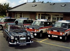 The Force's photographer was on hand the day in 1990s that an old Wolseley police car from three decades earlier paid a visit. The classic 1965 Wolseley 15/60, a stalwart of many police forces around the country, is photographed alongside some of GMPs fleet of motorway patrol Range Rovers at their base at Birch on the M62.  From the collection of the Greater Manchester Police Museum and Archives. For more information about Greater Manchester Police please visit our website. www.gmp.polic... British Police Cars, Old Police Cars, British Car, Emergency Vehicles, Police Vehicles, Garage Workshop Plans, Manchester Police, Range Rover Classic, Vintage Cars