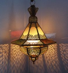 Beautiful hand hammered Moroccan Lampin traditional Fez style made of brass with Iraqi colored glass inserts.  This Moroccan Lamp with its beautiful cutouts design and colors will definitely add that special Moroccan flair that any of your rooms will truly appreciate!   Measures 17