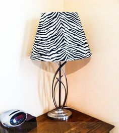 Recovering a lampshade with an old sheet.