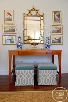 vignette, console, bamboo mirror, audubon prints, upholstered ottomans under console