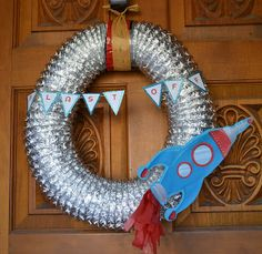 Welcome to MJ's Outta This World Birthday Party! Wreath made from dryer duct for space ship party.