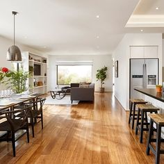 Look at that floor! Start with Bamboo flooring, add some pendant lights, a few black highlights and a Fiddle Leaf Fig Tree and you have yourself one stylish interior. Get this look with the gloriously glossy Zen Carbonised bamboo flooring. Pic from Fairhaven Homes. #godfreyhirst #godfreyhirstflooring #theflooringexperts #bamboo #bambooflooring #hardflooring #zen #interiors #interiordesign #homedecor #styling #fairhavenhomes #metricon