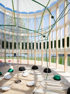 EcoLogicStudio has designed AirBubble, a children's play pavilion that uses algae in solar-powered bioreactors to remove carbon dioxide and pollutants from the air.
