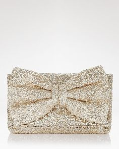 Betsey Johnson Bow-Tiful Sequin Clutch #weddingaccessories #metallicwedding | via Polyvore