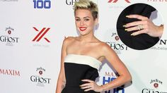 A few weeks ago, Miley Cyrus blasted rumors that her relationship with Liam Hemsworth was on the rocks-and now, she's taking things one step further: She's wearing her engagement ring again.On Wednesday night, the 20-year-old singer walked the red carpet at Maxim's 2013 Hot 100 party at Vanguard in