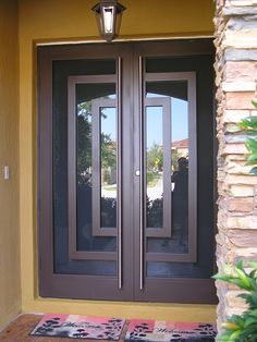 We offer the finest Hurricane Ornamental Wrought Iron Doors that come in a variety of styles and sizes. Door Gate Design, Door Design Interior, Wooden Door Design, Wrought Iron Security Doors, Wrought Iron Doors, Double Doors Exterior, Double Entry Doors, Iron Front Door, Pot Racks