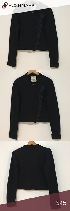 """Anthropologie Sparrow Cardigan Asymmetric Button Pre-owned Anthropologie Sparrow Cardigan/Sweater: Black. Long Sleeve. Asymmetrical Snap Ruffle Fabric Covered Buttons. Lightweight. Made of 100% Wool. Pit To Pit: 36"""". Length: 19.5"""". *Measurements are approximate* *Loose threads throughout some of the buttons* Appears to be no other visible/major flaws. Anthropologie Sweaters Cardigans"""