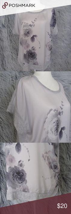 "Simply Vera PXL Gray Floral Watercolor Tunic Simply Vera   Petite XL   Short Sleeve Top   Gray Floral Purple   Semi Sheer   Roomy Short Sleeves  No holes, tears or stains.  Underarm to underarm: 24""  Length: 27.5"" Simply Vera Vera Wang Tops Tunics"