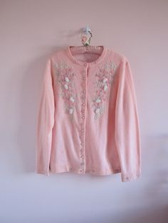 vintage pink cardigan.  floral and leaf beadwork with pearl clusters.  lined for extra warmth.  crew neckline.    estimated size - large, extra large