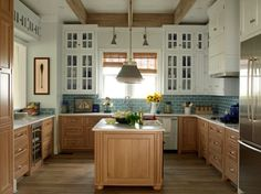 This gives me an idea for our cabinets -- stained oak on bottom and painted on top.  hmm... @Hollis Barton