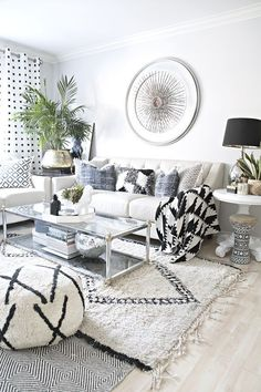 neutral, eclectic living room decor with jeans accents and black and white decor