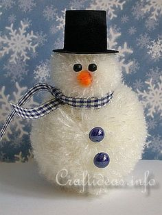 """Pom-Pom Snowman @Craftideas: For this project you will need: Sturdy Cardboard, Circle Templates, Scissors, Soft White Yarn, Orange Chenille, Black Snowman Hat, Blue Checked Ribbon, 2 x 4mm Wooden Black Beads, 2 x 8 mm Blue Half Beads, Craft Glue. Instructions:   1. Follow the instructions here """"How to Make a Pom-Pom"""" to make the head and body of the snowman. 2. Tie the 2 pom-poms together to create a snowman shape. 3. Glue on the snowman hat, the eyes, a piece of orange chenille for the…"""