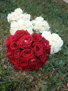 Red rose bride's bouquet & white bridesmaid's bouquets. <3