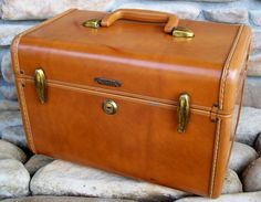 Vintage Samsonite Train Case ~ Would make a cute picnic basket or magazine bin.  I have a few of these & they are fantastic storage with the charm of vintage.