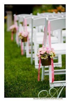Pails of prettiness hanging on aisle chairs! We could totally DIY this.