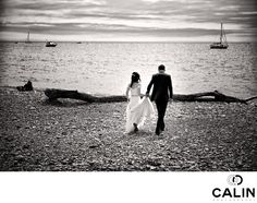 Toronto Wedding Photographer - Bride and Groom stroll on a beach: