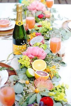 Absolutely love this floral and citrus tablescape for summer