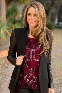 leather sleeves, fabric body jacket, shiny maroon blouse