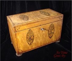Rare Federal Figured and Bird's Eye Maple Footed Tea Caddy.  The outer caddy is veneered with beautiful bird's eye maple and 4 oval inlaid panels with floral and leaf decorations.  Quarter fan inlaid case surrounded with tulipwood banding & sits on 4 lozenge/squashed bun feet via Rubylane/As Time Goes By