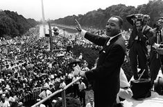 """From Remembering Martin Luther King Jr. in Photos, one of 37 photos. Civil rights leader Martin Luther King waves to supporters on August 1963 on the Mall in Washington DC during the """"March on. Nelson Mandela, Civil Rights Leaders, Civil Rights Movement, Political Leaders, Martin Luter King, Mark Martin, Geo Ado, Mississippi, King's Speech"""
