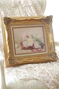 Painting in gilt frame of roses on a chair with lace is part of my cottage's charm