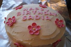 Underneath the pretty buttercream and pink flowers lies our vibrant red velvet cake